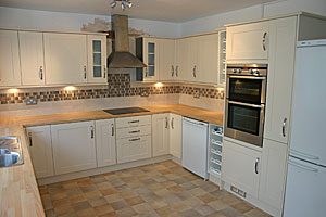 Kitchen Pelmet Lighting Builders coalville martin wyatt joinery and building services burford ivory shaker style door fitted to ivory carcasses with matching cornice and light pelmet free standing fridgefreezer free standing electric workwithnaturefo
